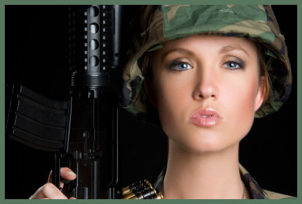 Sexy woman in military uniform with gun image